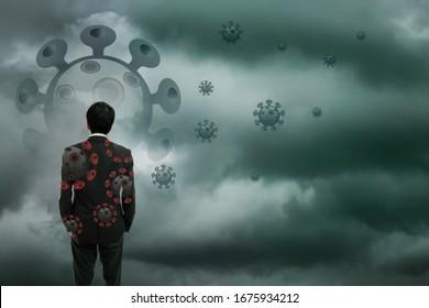 Defocused Businessman standing with corona virus or covid19 in cloudy background, Corona virus pandemic outbreak global crisis, Blurred or defocus technic