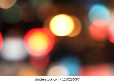 Defocused car lights in the evening traffic jam