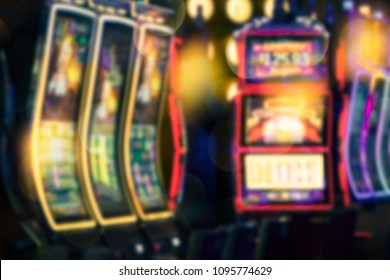 Defocused casino slot machine blur with colorful lights