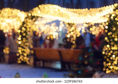 Defocused Christmas lights in city at night