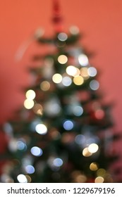 Defocused Christmas tree with colorful bokeh, Christmas background.