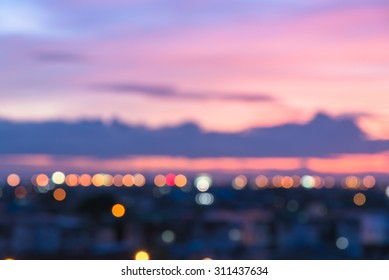 Defocused cityscape or city view with sweet pastel color sky and bokeh at sunset