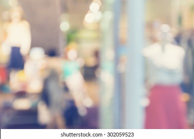 Defocused clothing store front entrance displaying woman's fashion