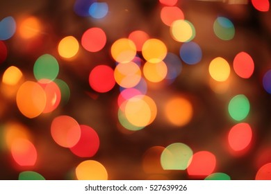 De-focused color background. Yellow Christmas light.
