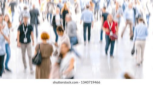 Defocused Crowd of people walking at a trade fair