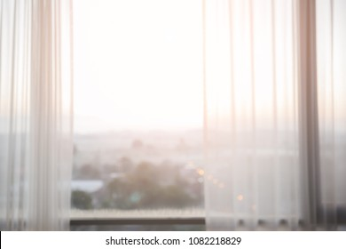 Defocused curtain window with sunlight in the early morning. For montage product display or design key visual layout
