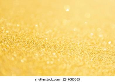 Defocused gold glitter background. Gold abstract bokeh background. Christmas abstract background