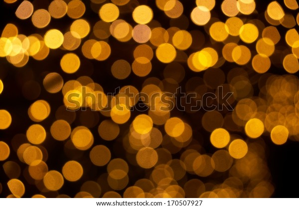 Defocused gold lights abstract background