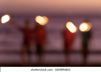 Defocused happy group of young girl friends hangout enjoy and play sparklers firework at evening sunset. Holiday, teenager and lifestyle concept. Defocused image.