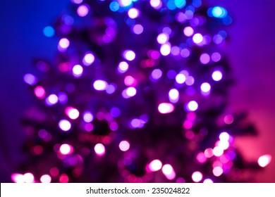Defocused holiday tree lights.