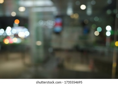 Defocused image of chairs and table in coffee house.Defocused shot inside cafe in the evening.Abstract blur and defocused restaurant and coffee shop cafe interior for background