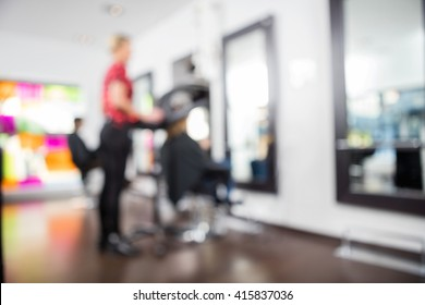 Defocused Image Of Hairdresser With Clients