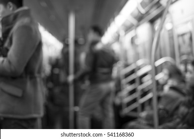 Defocused inside of subway train for backdrop or background in black and white