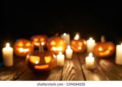 Defocused Jack-o-latern Halloween pumpkins with candles