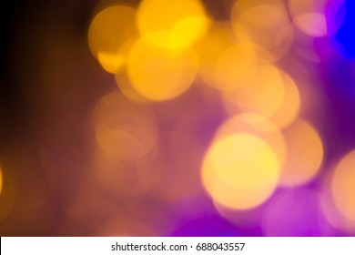 Defocused light with black background. Sparkle Night life light bokeh. Sparkle Yellow and blue bokeh of light with black background.