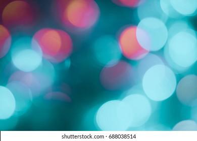 Defocused of light blue and orange LED light on black background. Bokeh photo of LED light. Blue and amber. Orange and teal Bokeh