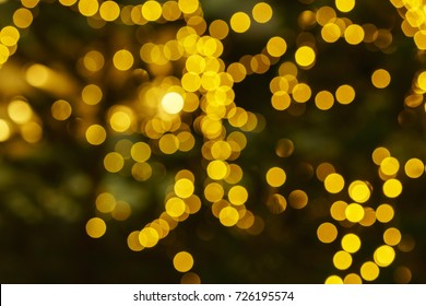 Defocused lights abstract golden nonagon bokeh background