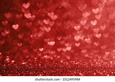 Defocused lights in the shape of red hearts, valentines day concept