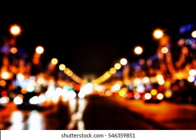 defocused lights of the street - Elysian Fields, Paris, Arc de Triomphe in the background