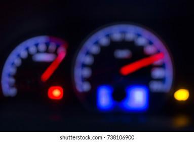 Defocused modern car dashboard. Bokeh background. Concept of drunkenness driving. Over speed.