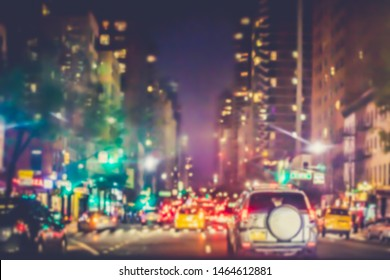 Defocused night blur, New York City Manhattan seen on busy street with cars, building and lights.