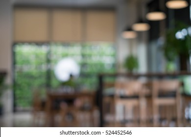 Defocused office background of a Board room with rustic wooden flooring, meeting table and eames chairs