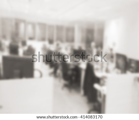 Defocused Office Space Background In Vintage Monochrome Colors. Blurred  Office With People Silhouettes. Working