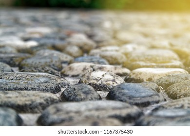 Defocused Pebbles Ancient Floor Background In Sunbeam Light ,closeup Big  Stones