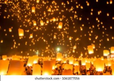 Defocused of People releasing paper Yee-Peng flying lantern in Kra thong festival, Chiang Mai, Thailand.