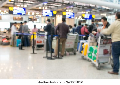 Defocused Of People In Row at Check-In Counter at Airport.