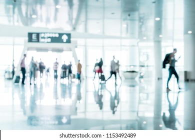 Defocused People Walking in Airport Terminal