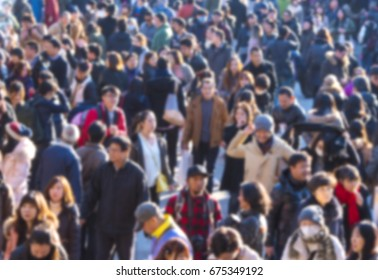 Defocused picture of crowd of people at the city