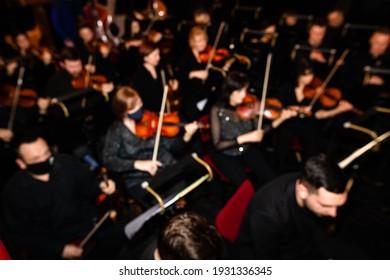 Defocused picture of orchestra in theatre