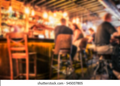 Defocused pub blur with people at the bar
