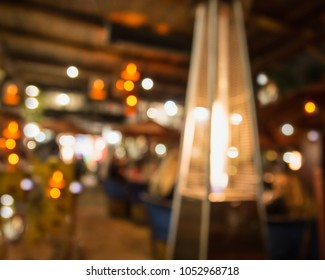 Defocused restaurant blur with light and gas heater