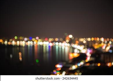 Defocused sea bay and  building of Pataya city in night time