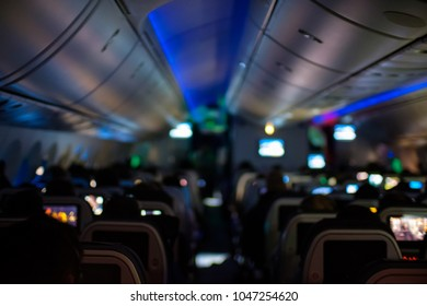 Defocused shot of an airplane cabin at night.