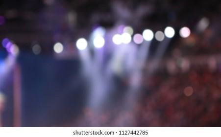 Defocused Spotlights with fog on stage.