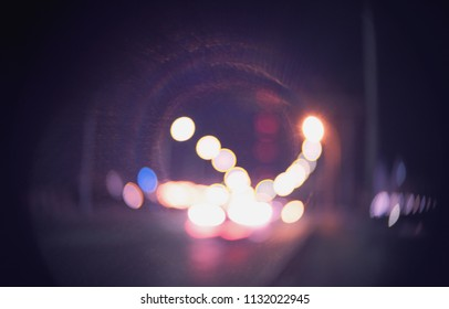 Defocused street with lamps in the night