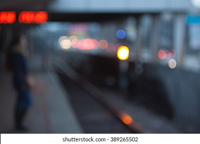 Defocused subway station. Evening city bokeh background.