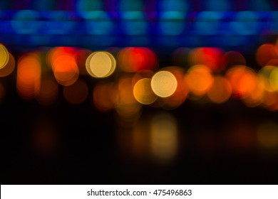 Defocused urban abstract texture background for your design. Multicolored defocused bokeh lights background.