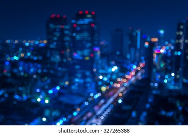 Defocused urban abstract texture -blurred background with bokeh of city lights from car on street at night