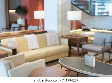 Defocused view of interior of an upmarket coffee shop or lounge with comfortable sofa