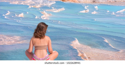 Defocused young girl looking at travertine pools and terraces in Pamukkale - Young girl sunbathing and sitting front travertine pools - Cotton castle in southwestern Turkey