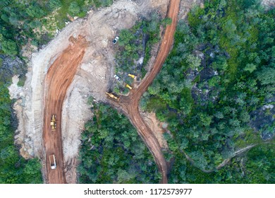 Deforestation aerial photo. Rainforest jungle in construction road site
