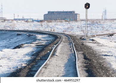 Deformation of the railway line, built in the permafrost. Polar tundra, Russia.