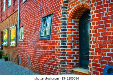 The deformed brick wall of Das Schwangere Haus in Luneburg, Germany.