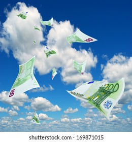 Deformed hundred-dollar bills euro against the sky.