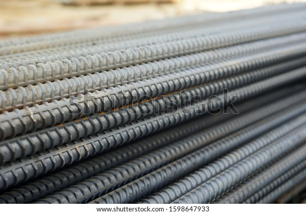 Deformed steel. Construction rebar steel work reinforcement in conncrete structure of building. Abstract metal background of steel pipes.