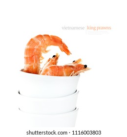De-frosted Vietnamese King Prawns shot against a white background in stacked white ceramic ramekins. From the Food-Art series of culinary images. Generous accommodation for copy space.